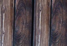 O fundo de madeira da textura do marrom escuro resistiu à parte velha da paralela de pano Fotos de Stock Royalty Free