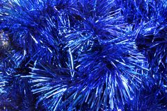 O fundo do azul do ouropel do Natal Imagem de Stock Royalty Free
