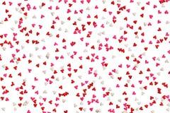 O fundo do coração polvilha no vermelho, no rosa e no branco Fotografia de Stock Royalty Free