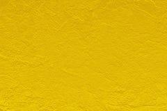 O fundo do sumário do teste padrão da textura da cor do ouro pode ser uso como a capa do folheto da poupança de tela do papel de  foto de stock