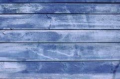 O fundo do velho pintado em placas azuis fotografia de stock royalty free