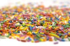 O fundo dos doces polvilha confetes imagens de stock