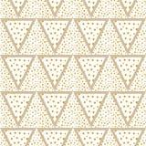 O fundo dos triângulos com ouro pontilha sem emenda fotografia de stock royalty free