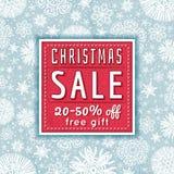 O fundo e a etiqueta azuis do Natal com venda oferecem Fotografia de Stock Royalty Free