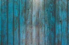 O fundo horizontal das placas verticais idosas é pintado na luz - cor azul Imagem de Stock