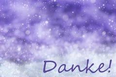 O fundo roxo do Natal, neve, flocos de neve, meios de Danke agradece-lhe Imagem de Stock Royalty Free