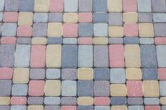 O fundo, textura de pavers coloridos urbanos molda em geral Quadro horizontal Fotos de Stock Royalty Free