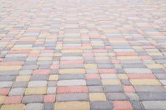 O fundo, textura de pavers coloridos urbanos molda em geral Quadro horizontal Foto de Stock