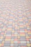 O fundo, textura de pavers coloridos urbanos molda em geral Quadro vertical Fotografia de Stock Royalty Free