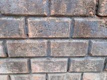 O fundo velho da parede de tijolo foto de stock