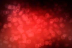 O fundo vermelho de Abstrack com luzes do brilho do bokeh e aquece-se e v Imagem de Stock