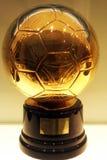 O futebol dourado foto de stock