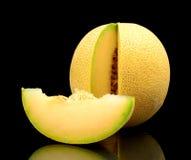 O galia do melão entalhado com fatia isolou o preto no estúdio imagem de stock royalty free