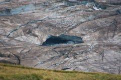 O gelo quebrado na geleira alpina velha Fotografia de Stock