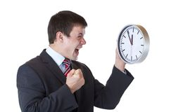 O gerente sob a pressão de tempo aperta seu punho Imagens de Stock