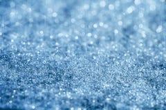 O glitter azul sparkles fundo com luz da estrela Foto de Stock