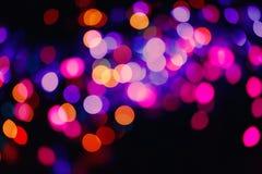 O Glitter ilumina o fundo Textura do bokeh do feriado Luz colorido fotos de stock