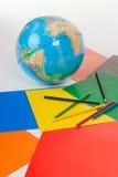 O globo, papel, lápis imagem de stock royalty free