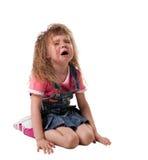 O grito da criança senta-se no branco - isolado Fotografia de Stock
