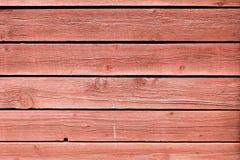 O Grunge que descasca o carvalho pintado vermelho embarca o fundo Imagens de Stock