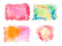 O grupo de aquarela colorida espirra isolado no fundo branco Fotos de Stock