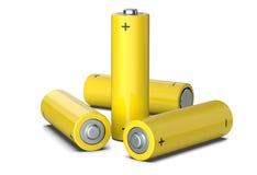 O grupo de baterias amarelas do tamanho do AA isoladas no branco, 3D rende Foto de Stock