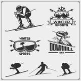 O grupo de esportes de inverno simboliza, etiquetas e elementos do projeto Esqui, em declive, slalom ilustração stock