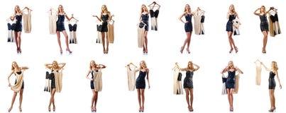 O grupo de fotos com a mulher que tenta a roupa nova Fotografia de Stock