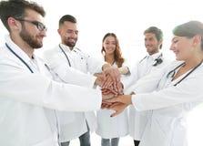 O grupo de internos médicos mostra sua unidade Fotografia de Stock Royalty Free