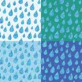 O grupo de quatro testes padrões sem emenda com chuva deixa cair Fotografia de Stock Royalty Free