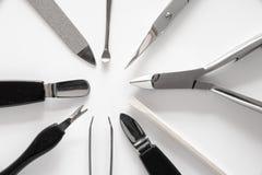 O grupo de tratamento de mãos metálico utiliza ferramentas o macro foto de stock