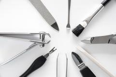 O grupo de tratamento de mãos metálico utiliza ferramentas o macro imagens de stock