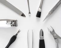 O grupo de tratamento de mãos metálico utiliza ferramentas o macro Imagens de Stock Royalty Free