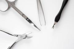 O grupo de tratamento de mãos metálico utiliza ferramentas o macro imagem de stock