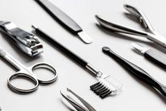 O grupo de tratamento de mãos metálico utiliza ferramentas o macro fotografia de stock