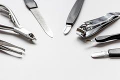 O grupo de tratamento de mãos metálico utiliza ferramentas o macro Fotos de Stock