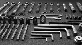 O grupo do gigante de mão da engenharia utiliza ferramentas o stidio isolada Fotografia de Stock