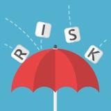 O guarda-chuva protege contra o risco Imagem de Stock Royalty Free