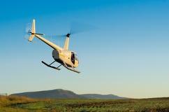O helicóptero descola Fotografia de Stock Royalty Free