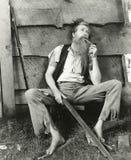 O Hillbilly fuma o cano de barro Imagens de Stock Royalty Free