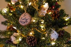 O holy night and other ornaments on a christmas tree stock photo