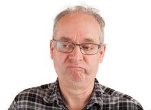 O homem é desagradado sobre algo Fotografia de Stock Royalty Free