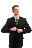 O homem abotoa um terno Imagens de Stock Royalty Free