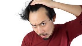 O homem asiático obtém calvo fotografia de stock