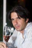 O homem bebe o vinho Fotos de Stock Royalty Free