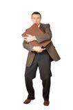 O homem clasped uma mala de viagem pelas mãos foto de stock