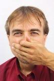O homem cobre sua cara com sua mão Imagens de Stock Royalty Free