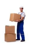 O homem com as caixas isoladas no branco Imagem de Stock Royalty Free