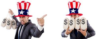 O homem com o chap?u americano com moneybags fotografia de stock royalty free