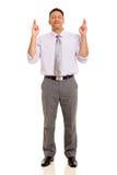 O homem com dedos cruzou-se Imagens de Stock Royalty Free